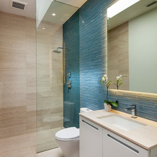 Contemporary bathroom in Los Angeles with flat-panel cabinets, white cabinets, an open shower, blue tile, matchstick tile, an undermount sink and an open shower.