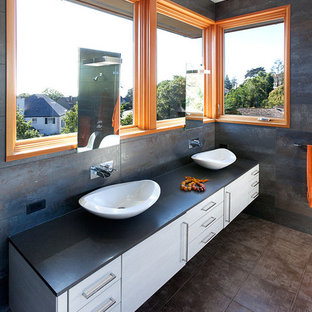 Trendy gray tile bathroom photo in San Francisco with a vessel sink