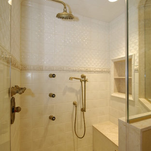 Bathroom - mid-sized mediterranean beige tile and porcelain tile mosaic tile floor bathroom idea in Bridgeport with an undermount sink, raised-panel cabinets, dark wood cabinets, limestone countertops and yellow walls