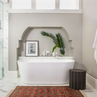 Inspiration for a mid-sized transitional master stone tile marble floor and white floor bathroom remodel in Calgary with beige walls, a hinged shower door and marble countertops