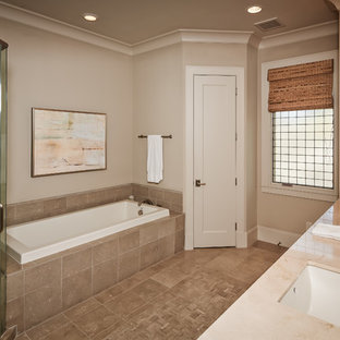 Inspiration for a mid-sized timeless beige tile bathroom remodel in Houston with marble countertops, shaker cabinets, white cabinets, beige walls and an undermount sink