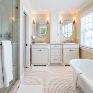 Mid-sized elegant master beige tile and travertine tile beige floor bathroom photo in New York with shaker cabinets, white cabinets, beige walls, an integrated sink and a hinged shower door