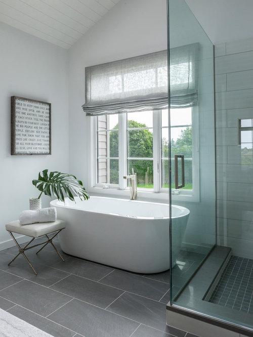 example of a classic gray floor bathtub design in new york