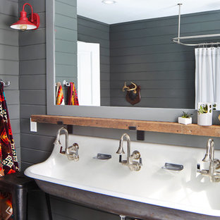 Farmhouse family bathroom in Grand Rapids with grey walls, a trough sink and a shower curtain.