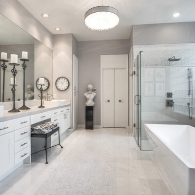 Bathroom - large modern master white tile and porcelain tile marble floor and white floor bathroom idea with shaker cabinets, white cabinets, gray walls, a vessel sink, marble countertops, a hinged shower door and white countertops