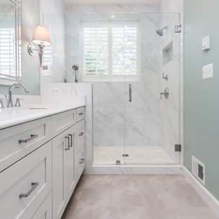 Alcove shower - small transitional master white tile and marble tile porcelain tile and beige floor alcove shower idea in DC Metro with shaker cabinets, gray cabinets, a two-piece toilet, an undermount sink, quartz countertops, a hinged shower door, gray walls and white countertops