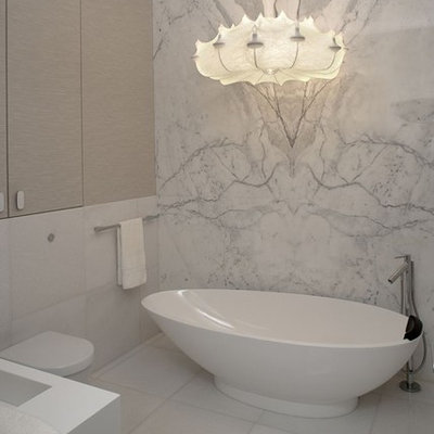 Trendy marble tile freestanding bathtub photo with a wall-mount toilet