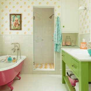 This is an example of a mid-sized beach style kids bathroom in Los Angeles with a drop-in sink, green cabinets, engineered quartz benchtops, a claw-foot tub, ceramic tile, multi-coloured walls, painted wood floors and open cabinets.