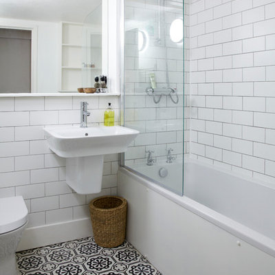Bathroom - small transitional white tile and subway tile bathroom idea in London with a wall-mount sink, a one-piece toilet and white walls