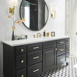 Sliding shower door - mid-sized transitional master black tile and marble tile mosaic tile floor and black floor sliding shower door idea in Dallas with recessed-panel cabinets, black cabinets, yellow walls, an undermount sink, quartzite countertops and white countertops