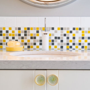 This is an example of an eclectic bathroom in Other with yellow tile and mosaic tile.