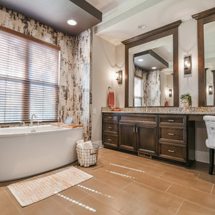 Example of a transitional multicolored tile brown floor freestanding bathtub design in Charlotte with recessed-panel cabinets, dark wood cabinets, gray walls and gray countertops