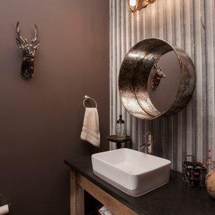 Imagen de cuarto de baño con ducha, rústico, de tamaño medio, con armarios abiertos, puertas de armario de madera oscura, sanitario de dos piezas, paredes púrpuras, lavabo sobreencimera y encimera de acrílico
