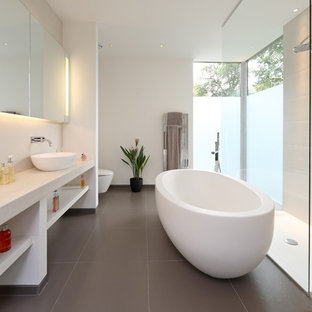 Photo of a contemporary bathroom in Other with a vessel sink, open cabinets, white cabinets, a freestanding bath, a walk-in shower, white tiles, white walls and an open shower.