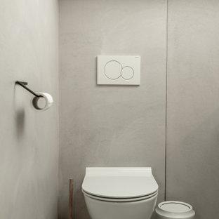 Стильный дизайн: маленькая главная ванная комната в стиле модернизм с фасадами с декоративным кантом, фасадами цвета дерева среднего тона, столешницей из бетона и розовой столешницей - последний тренд