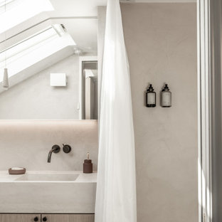 Small modern ensuite bathroom in London with concrete worktops, flat-panel cabinets, grey cabinets, grey tiles, an integrated sink, a shower curtain and grey worktops.