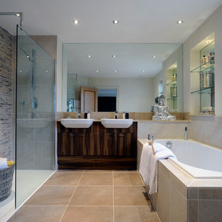 Inspiration for a transitional master bathroom remodel in London with a vessel sink, flat-