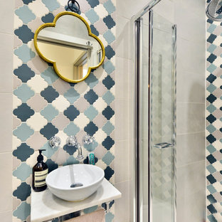 Small mediterranean shower room bathroom in London with a walk-in shower, a hinged door, beige tiles, blue tiles, grey tiles, white tiles, beige walls and a vessel sink.