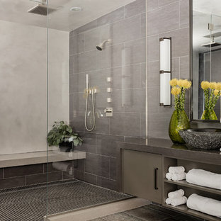 Alcove shower - large contemporary master gray tile and porcelain tile travertine floor alcove shower idea in Boston with flat-panel cabinets, gray cabinets, gray walls, a vessel sink, quartz countertops and a hinged shower door