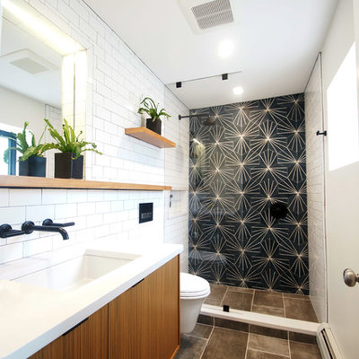 Small minimalist 3/4 white tile and subway tile porcelain tile and gray floor wet room photo in Boston with flat-panel cabinets, medium tone wood cabinets, a one-piece toilet, gray walls, an undermount sink, quartz countertops, a hinged shower door and white countertops