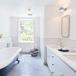 Inspiration for a transitional master white tile and subway tile claw-foot bathtub remodel in New York with flat-panel cabinets, white cabinets, white walls and an undermount sink