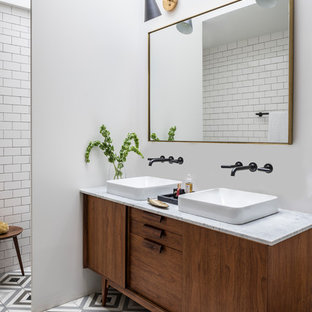Danish master white tile and subway tile cement tile floor and multicolored floor bathroom photo in New York with furniture-like cabinets, dark wood cabinets, white walls, a vessel sink and gray countertops