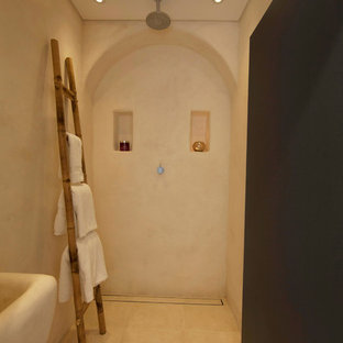 Design ideas for a small mediterranean bathroom in Sydney with a walk-in shower, beige walls, a wall-mounted sink, ceramic flooring, beige floors and an open shower.
