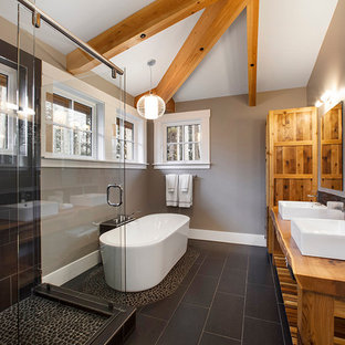 Inspiration for a contemporary black tile black floor bathroom remodel in Vancouver with a vessel sink, medium tone wood cabinets, open cabinets, wood countertops and brown countertops