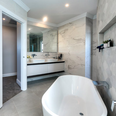 Inspiration for a contemporary master gray tile freestanding bathtub remodel in Sydney with flat-panel cabinets, white cabinets and a vessel sink