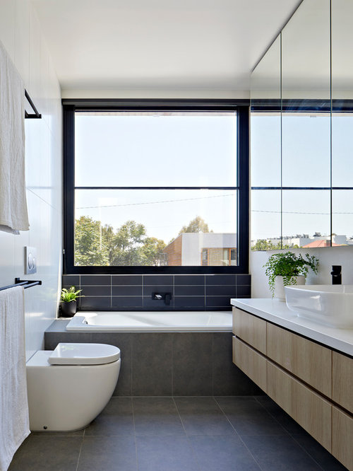 Inspiration For A Contemporary Bathroom In Melbourne With Flat Panel  Cabinets, Light Wood Cabinets