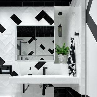На фото: ванная комната среднего размера в стиле лофт с белой плиткой, черной плиткой, подвесной раковиной и тумбой под одну раковину с