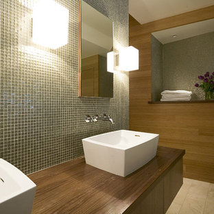 Bathroom - modern mosaic tile bathroom idea in San Francisco with a vessel sink and wood countertops