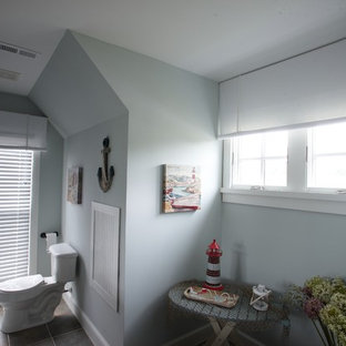 Inspiration for a mid-sized timeless 3/4 ceramic tile bathroom remodel in Columbus with a one-piece toilet, gray walls, an undermount sink and solid surface countertops
