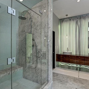 Example of a large trendy gray tile and glass tile marble floor double shower design in Atlanta with flat-panel cabinets, white walls and a vessel sink