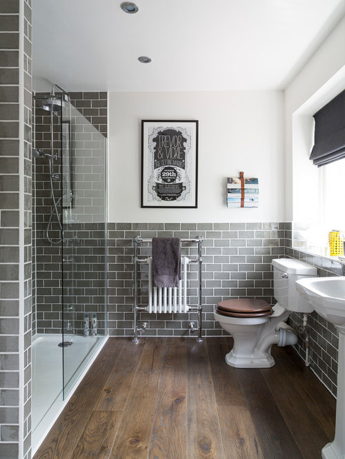 traditional gray tile and subway tile dark wood floor and brown floor alcove shower idea in - Traditional Bathroom Tile Designs