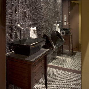 Trendy black tile and mosaic tile bathroom photo in San Francisco with a vessel sink, dark wood cabinets and an urinal