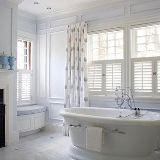 Elegant white tile freestanding bathtub photo in Boston