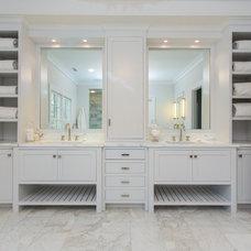 Transitional Bathroom by SIR Development