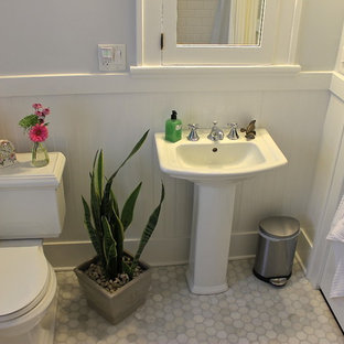 Small elegant gray tile and stone tile marble floor bathroom photo in Other with a pedestal sink, a two-piece toilet, open cabinets, white cabinets and gray walls
