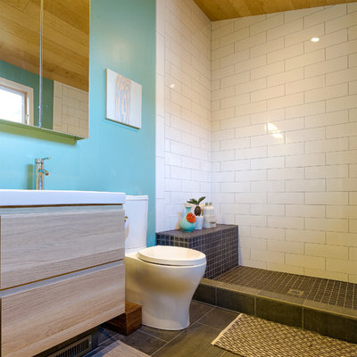 Trendy white tile and subway tile bathroom photo in San Francisco with flat-panel cabinets, light wood cabinets and a two-piece toilet