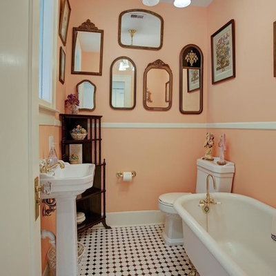 Small arts and crafts black and white tile and ceramic tile mosaic tile floor claw-foot bathtub photo in Houston with a two-piece toilet, pink walls and a pedestal sink