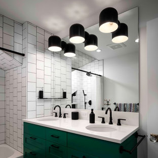 Inspiration for a large traditional family bathroom in Portland with recessed-panel cabinets, green cabinets, an alcove bath, a shower/bath combination, a one-piece toilet, white tiles, ceramic tiles, white walls, mosaic tile flooring, a submerged sink, quartz worktops, black floors, a shower curtain and white worktops.