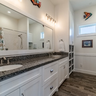 Inspiration for a large coastal kids' white tile and subway tile ceramic tile and brown floor bathroom remodel in Houston with shaker cabinets, white cabinets, a two-piece toilet, beige walls, an undermount sink and granite countertops