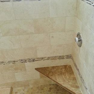 Cette photo montre une très grand salle de bain principale sud-ouest américain avec un lavabo posé, un placard avec porte à panneau surélevé, des portes de placard en bois sombre, un plan de toilette en granite, une baignoire posée, une douche d'angle, un carrelage beige, un carrelage de pierre, un mur beige et un sol en travertin.