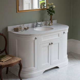 Medium sized traditional family bathroom in Cambridgeshire with shaker cabinets, medium wood cabinets, a claw-foot bath, a built-in shower, a one-piece toilet, white tiles, ceramic tiles, white walls, porcelain flooring, a pedestal sink and marble worktops.