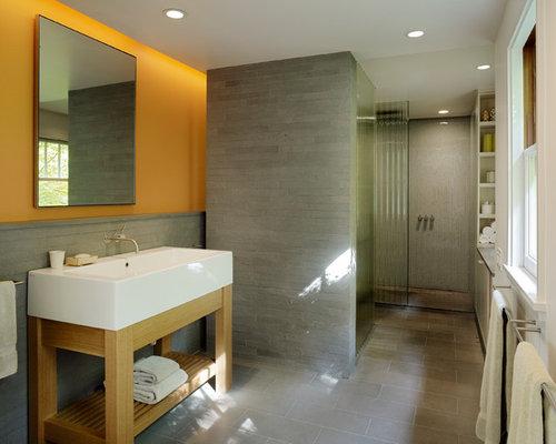 modern gray floor bathroom idea in san francisco with orange walls - Bathroom Ideas Orange