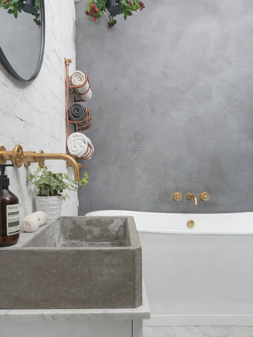 This Is An Example Of An Industrial Bathroom In London With A Freestanding  Bath, A