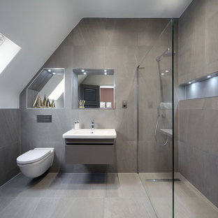 Design ideas for a mid-sized contemporary 3/4 bathroom in London with an open shower, a wall-mount toilet, a wall-mount sink and an open shower.