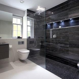 Immagine di una stanza da bagno con doccia minimal di medie dimensioni con lavabo integrato, doccia aperta e WC sospeso