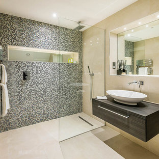 Photo of a medium sized contemporary shower room in Surrey with a vessel sink, a walk-in shower, beige tiles, beige walls, dark wood cabinets and an open shower.